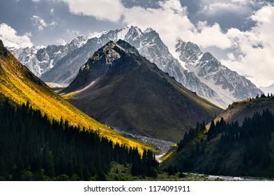 Beautiful landscape of snowy mountains in green valley of Left Talgar in Kazakhstan, Central Asia
