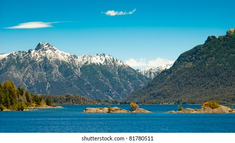 Beautiful landscape with snowy mountains green forest in Nahuel Huapi lake Patagonia Argentina