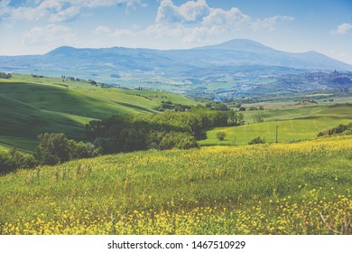Beautiful landscape, spring nature. Mountain landscape. View of sunny fields on rolling hills in Tuscany, Italy