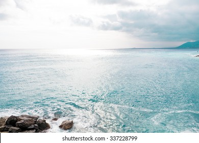 Beautiful landscape with sunlight sky and horizon over the blue sea background. Peace and serenity concept.