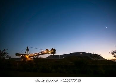 Beautiful landscape sunrise at isolated iron ore reclaimer mining site Pilbara region outback Perth, Australia