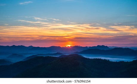 Beautiful landscape of Sunrise with mist, sky and cloud view from top mountain at Phu Bo Bit, Loei, Thailand