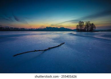beautiful landscape of sunrise over frozen lake