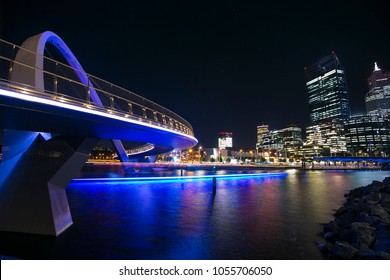 Beautiful landscape sunset during twilight of Perth city and Elizabeth Quay bridge on left, blue blurry boat light in the river, in Perth city CBD, Western of Australia