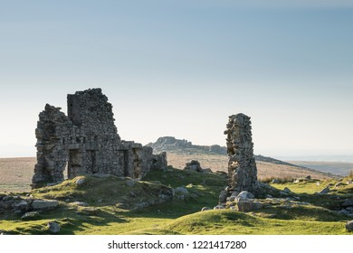 Beautiful landscape sunset image over abandoned Foggintor Quarry in Dartmoor with raking soft sunlight over ruins and derelict buildings