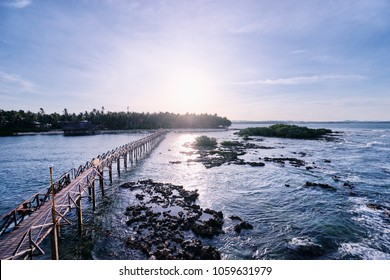 Beautiful landscape. Sunset on the seashore. Wooden bridge on Cloud 9 beach, Siargao Island Philippines.