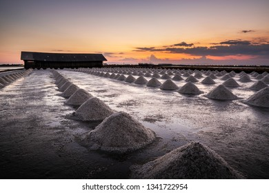 Beautiful landscape at sunset salt Farming. sea-salt production in the country, Sunset in Salt farming at Samut Sakhon Thailand.