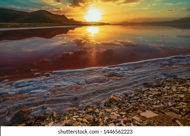 beautiful landscape and sunset with sky reflection over salty Lake Maharlu in Iran, Fars Province near Shiraz city, with incredibly red water like blood