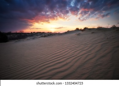 Beautiful Landscape with sunset sky and wavy sand. Composition of nature