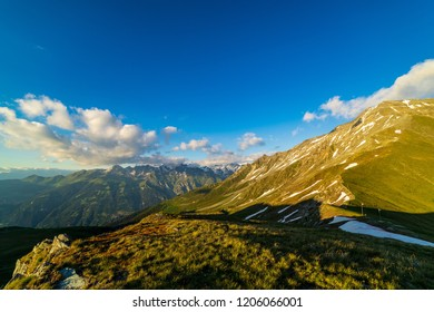 Beautiful landscape of Swiss Alps in a Val De Bagnes area. Dramatic sunset scene in high mountains. Clouds covering high peaks of Valais Alps (Pennine Alps), Switzerland in a evening light.