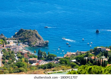 Beautiful landscape of Taormina with blue sea and rocky coast, Sicily, Italy.