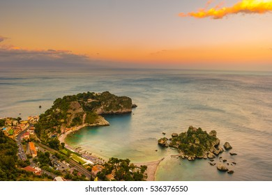 Beautiful landscape of Taormina, Italy. Sicilian seascape with beach and island Isola Bella. Travel photography.