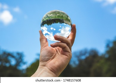 A beautiful landscape with trees and clouds in clear crystal glass ball