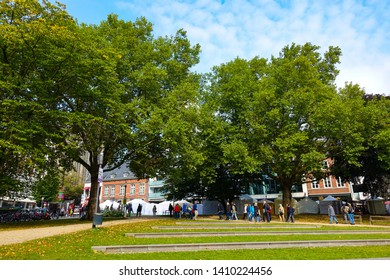 Beautiful landscape of trees and people in Aachen park, Aachen, Germany, 30.08.2018