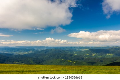 beautiful landscape under the summer sky. fluffy clouds over the mountain ridge. pleasant atmosphere and good day for a hike. lovely nature background
