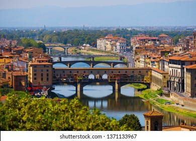 Beautiful landscape view of amazing Florence city with famous medieval stone bridge Ponte Vecchio and the Arno River at sunset. Firenze scenery panorama, Italy Europe. Italian summer vacation.