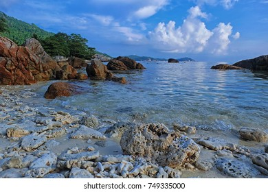 Beautiful landscape view of a coral filled beach in Perhentian Island. Soft focus effect due to usage of big aperture setting.