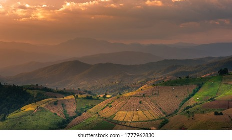 Beautiful landscape view of rice terraces and house on mountains beautiful shape in nature at pa-pong-peang rice terrace north Thailand.The village is in a valley among the rice terraces. Terraced Pad