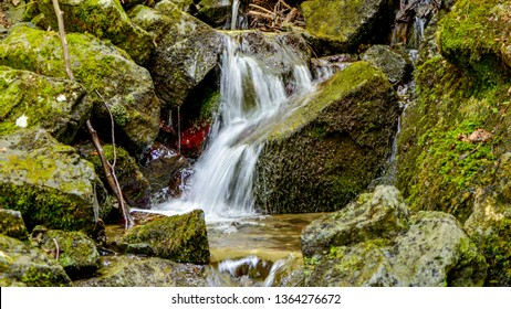 Beautiful landscape view of small waterfall in the river with water stream flowing through stone