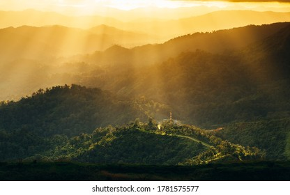 beautiful landscape view of sunset over the mountain at Thailand. Light phenomenon
