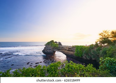 Beautiful landscape view of Tanah Lot water temple on sea coast at sunset time in Bali. Indonesia.