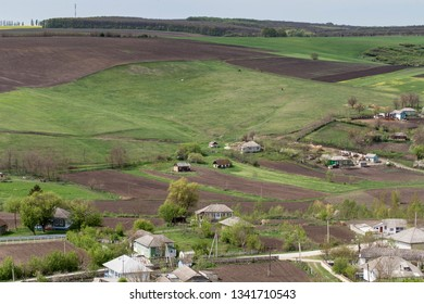 Beautiful landscape of the village and field and hills.