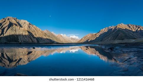 Beautiful landscape with water reflection on the way to Zanskar road at Himalaya Range, Zanskar Range, Pensi La, Jammu and Kashmir.