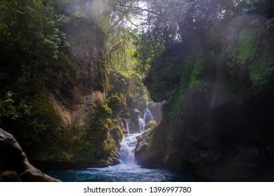 beautiful landscape of waterfalls and river, large stones with moss surrounded by green nature in Puente de Dios, Tamasopo, San Luis Potosí, México.