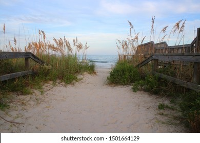 Beautiful landscape with way to the Atlantic beach. Scenic view with way to the beach through sand dunes and calm ocean during sunset at Pawleys Island, South Carolina, USA.