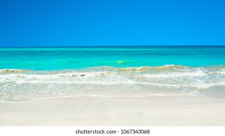 Beautiful landscape of white sandy beach with clear turquoise water in Saasiyat island, United Arab Emirates