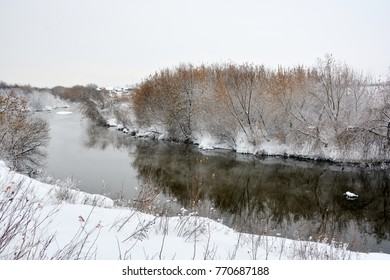 Beautiful landscape of winter forest river with reflection in water