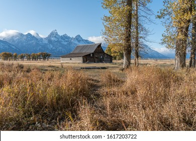 Beautiful Landscapes Of Wyoming In Grand Teton National Park With Iconic Moulton Barn In Background..