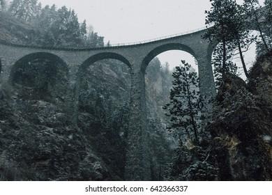 Beautiful Landwasser Viaduct in Switzerland in overcast day, snowfall