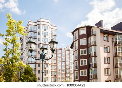 Beautiful lantern on background of new-constructed multi-storey houses. Stylish residential quarter. New family life in the city. Light in the life. Europe building