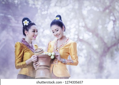 Beautiful Laos Women wearing Laos traditional dress costume,Asian girl wearing traditional Laos culture,vintage style,traditional of Laos suit.