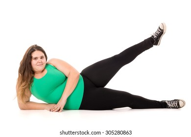 Beautiful large girl doing fitness exercises isolated in white