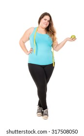 Beautiful large girl with measuring tape and apple isolated in white