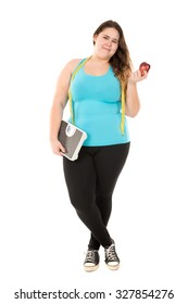 Beautiful large girl with a weight scale, measuring tape and an apple isolated in white