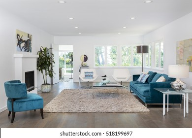 Beautiful and large living room interior with hardwood floors an