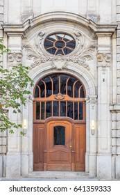 Beautiful large neo-classical portal with wooden door at historic Gendarmenmarkt, Berlin.