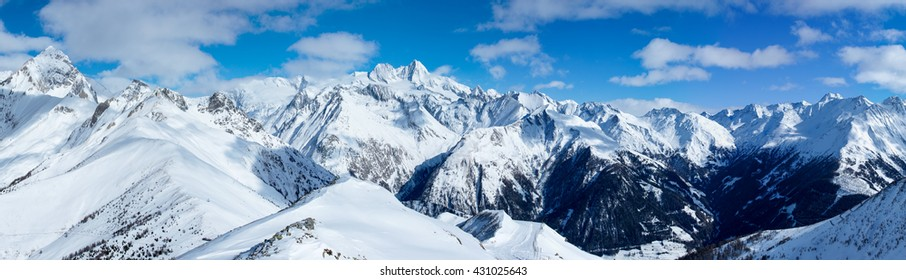 Beautiful large scale panorama shot of the impressive alpine landscape of the Autrian Hohe Tauern region surrounding Austria's highest mountain, the Grossglockner, shot on a lovely winter's day