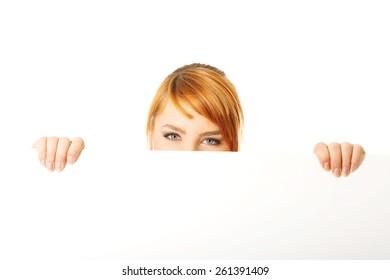 Beautiful large woman holding a white board