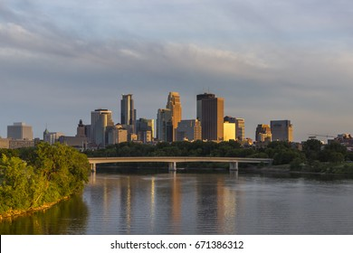 Beautiful late afternoon sun over the Minneapolis skyline. The image shows the Plymouth Bridge over the Mississippi River as seen from the Northeast.