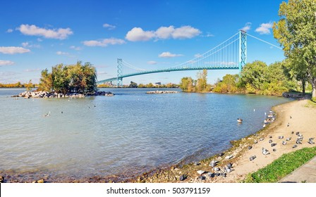 Beautiful late Autumn day at the Windsor, Ontario, Canada waterfront park on the Detroit River, looking at the Ambassador Bridge crossing from Windsor, Ontario, Canada to Detroit,  Michigan.