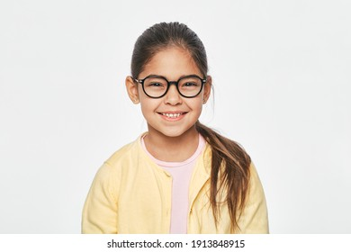 Beautiful Latin American little girl in stylish red glasses on light gray background