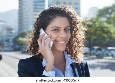 Beautiful latin businesswoman at phone