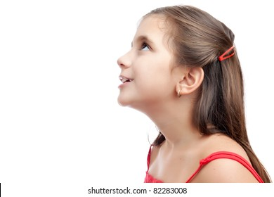 Beautiful latin girl looking up with a curious or hopeful look  isolated on a white background