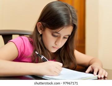 Beautiful latin girl working on her school homework