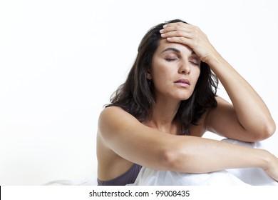 beautiful latin woman having headache