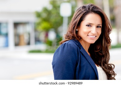 Beautiful Latin woman looking happy and smiling